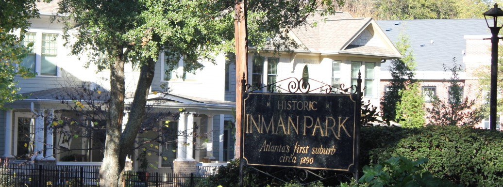 Picture of welcome to Inman Park sign in front of typical Inman Park Real Estate