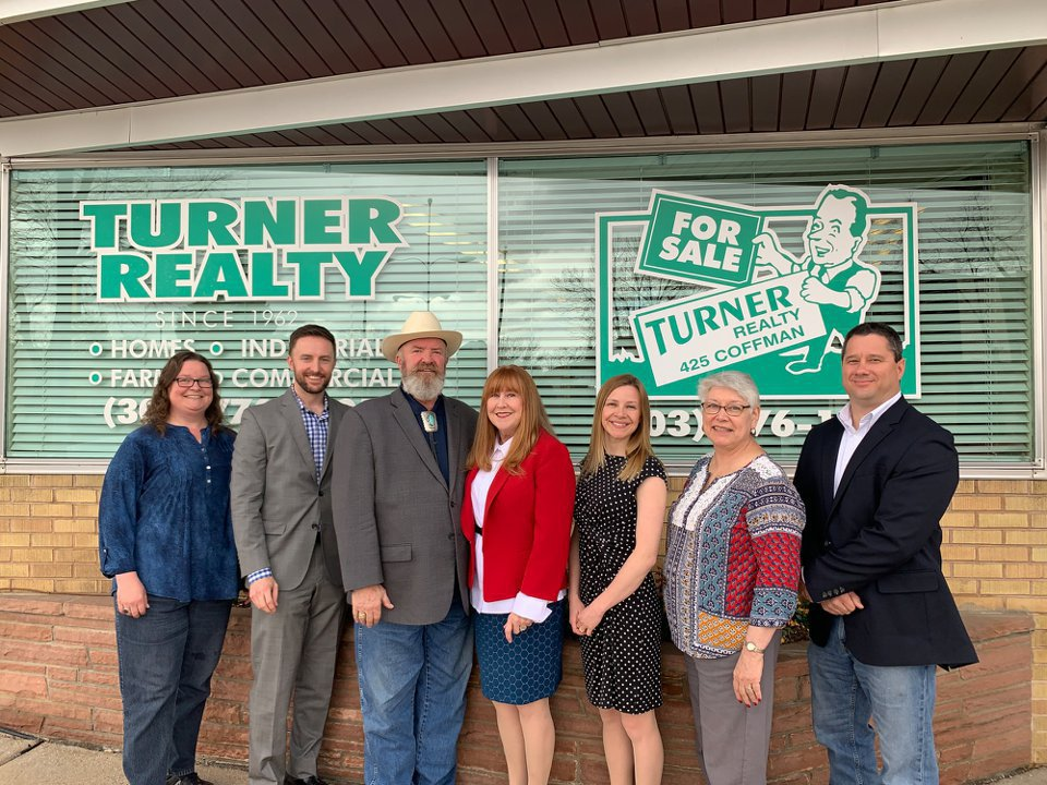 Our Longmont Realtors team standing in front of the office